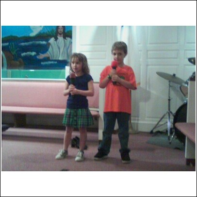 "Our youngest singers Lexi & Alex singing ""So Good to Me""."